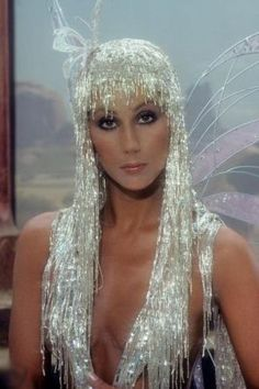 "Cher is another singer who i think would be great for my ""eccentric"" idea. She has worn alot of bold, sparkly outifts, but im not sure if she would be easily recognisable if i where to recreate her look."