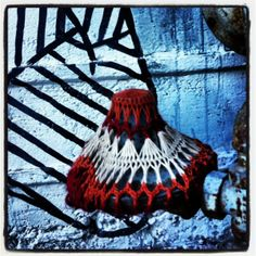 A yarnbomb I spotted out and about, against a wall covered in a mural