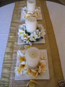 Table runner with candles and frangipanis