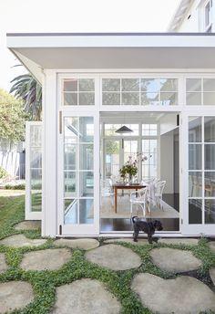 Elegant, glassed sunroom conservatory in heritage Sydney home.