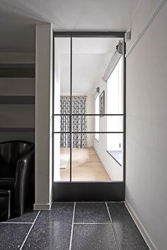 modern glass pivot door custom made by anyway doors this unique steel look pivoting door. Black Bedroom Furniture Sets. Home Design Ideas