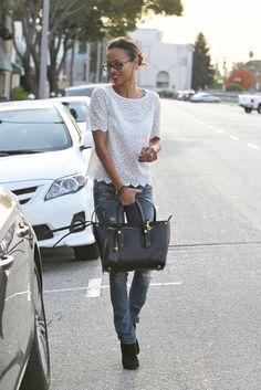 White lace, jeans, black purse