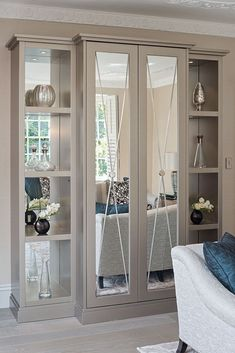 A bespoke mirrored drinks cabinet with sliding doors © Hill House Interiors