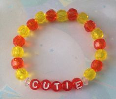 Such a CUTIE word bracelet.   https://www.etsy.com/listing/169536175/cutie-yellow-orange-beaded-kids-bracelet