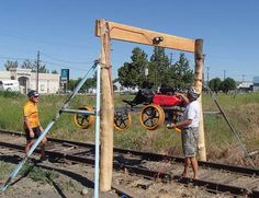The rail riding cars get raised up