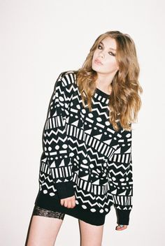 geometric  Sweater ♥ Don't like the sweater or print but I do like her hair!!