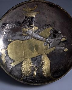 Large Plate with a Prince Holding a Mare ProvenanceIran PeriodPersia, Sasanian period Century4-5c MaterialsParcel gilded Silver DimensionsD-30