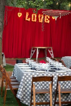 """Modern wedding reception decor idea - outdoor wedding reception with black + white table linens, hanging umbrellas and """"LOVE"""" marquee lights  {The Big Affair}"""