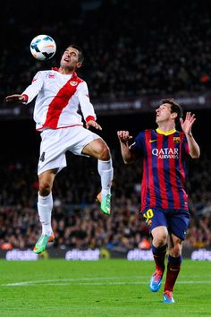 Lionel Messi of FC Barcelona duels for the ball with Iago Falque of Rayo Vallecano during the La Liga match between FC Barcelona and Rayo Vallecano de Madrid at Camp Nou on February 15, 2014 in Barcelona, Catalonia.