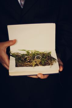 I think the faeries would approve of these wedding rings emerging from a lovely shock of moss....