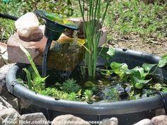 Making a container water garden  http://homewatergardenideas.com/category/small-water-garden/