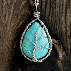 Wire wrapped pendant, Silver, Turquoise, Tree of life necklace. $30.00, via Etsy.