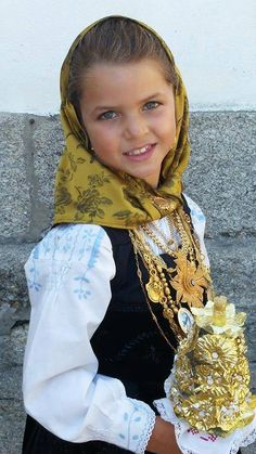 "Her name is Beatriz. very preety girl dressed in traditional minho costume. ""north of portugal"" and everything is made out of real gold."
