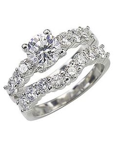 Pretty rings!! I like how the band is curved in so it looks like a part if the original engagement ring when you wear it :)