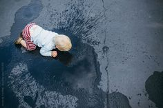 Stock photo of Birds Eye View of Toddler Boy Crawling Through Puddles by Amandavoelker Playing With Hair, Blue Rain, Birds Eye View, Toddler Boys, Baby Boy, Stock Photos, Little Boys, Toddlers, Boy Newborn