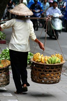 Bananas  Vietnam. people working with Basket#woman #basket #people#working #work#wicker basket