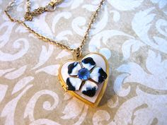 Vintage Enamel Flower on Heart Gold Filled Locket by charmingellie, normally not something id like but i do