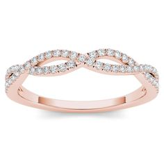 Featuring the soft and sweet beauty in rose gold, this band is pave-set with shimmering round diamonds that grab the eye and just don't let go. For a woman with distinctive taste, this polished diamond band is the perfect surprise.