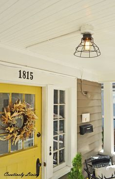 replace your light fixture for under 20 with no wiring, lighting, outdoor living Basket Lighting, Porch Lighting, Outdoor Lighting, Lighting Ideas, Replace Light Fixture, Light Fixtures, Light Bulb, Distressing Painted Wood, Adirondack Furniture