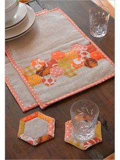 Now I know what to do with my excess hexies. Hexagon Place Mats & Coasters - Interweave