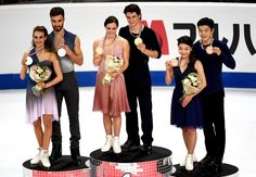First placed Canadian Tessa Virtue and Scott Moir (C), second placed French Gabriella Papadakis and Guillaume Cizeron (L) and third placed US Maia Shibutani and Alex Shibutani (R), pose on the podium with their medals after competing in the senior Ice Dance free dance program at the ISU Grand Prix of figure skating Final, on December 10, 2016 in Marseille, southern France