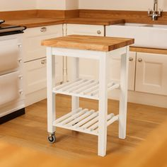 If you're looking for a wooden kitchen trolley to match your light and airy space, consider our painted butcher block trolleys. They are painted in Farrow & Ball's New White and finished with a 40mm thick solid oak worktop. Visit our website to find out more: http://www.worktop-express.co.uk/white-kitchen-trolley-oak-butchers-block