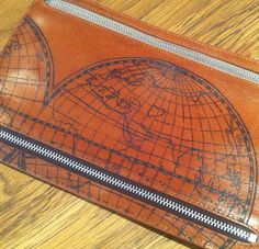 Map of the world tattoo on a leather wallet