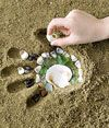 Sandy Hand Mosaic. A fun summertime craft for kids and a great way to preserve their precious little hand prints.