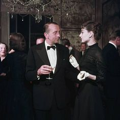 Whitney Warren talking to film star Audrey Hepburn at a party in San Francisco. His father, Whitney Warren senior was rather a close friend of architect Stanford White, signing his letters to him 'Bibi' or 'Bebe La Poupette'. Photo: Slim Aarons/Getty Images.