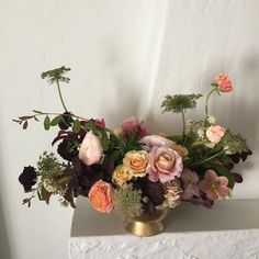 Peach and pink wedding centerpiece with dark and moody elements. Honey and Poppies. www.honeyandpoppies.com