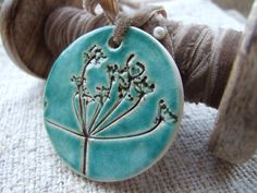 Turquoise ceramic pendant, Cow parsley, Queen Anne's Lace vintage velvet ribbon teal, nature inspired by damsontreepottery on Etsy https://www.etsy.com/listing/89932878/turquoise-ceramic-pendant-cow-parsley