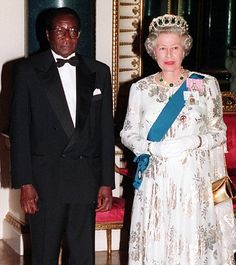 Robert Mugabe pictured with the Queen during his state visit to Britain in when he was awarded the honorary knighthood. Amazing how opinions change in a few short years. African Dictators, Comparative Politics, Baby Baker, Gordon Brown, Money Notes, Apron Designs, Zimbabwe, African History, Queen Elizabeth