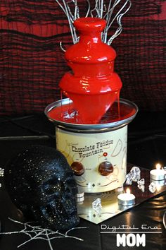 Death By Chocolate Blood Fondue Fountain.... putting blood red fondue into a fountain! Cool #party idea.