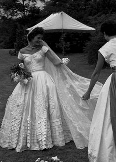 September 12, 1953   The wedding dress, now in the possession of the Kennedy library in Boston, was designed and made by African-American dress maker Ann Lowe, a couturier famous for many rich and famous people.