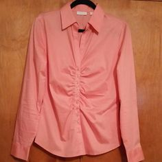 New York & Company Madison Button Down Blouse Madison ruched button down blouse/shirt.  Long sleeve.  Color is a pinkish coral or salmon. 60% cotton, 35% polyester, 5% spandex.  I've outgrown it, so it was only worn one. Like new condition. New York & Company Tops Button Down Shirts