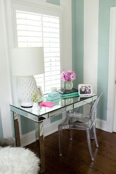 The duck egg blue stripes, sumptuous mirrored desk and white shutters creates a truly tasty shabby chic look.