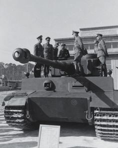 Generalfeldmarschall Erwin Rommel (left) and Army officials inspects one of the early Tiger Tank, possibly in Kummersdorf in 1942.