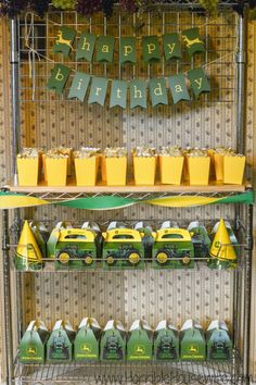 John Deere party favors set up for a John Deere birthday party. #showusyourmess #pmedia #ad