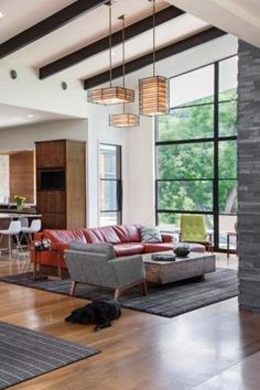 We love using multiple modern chandeliers in big rooms, as shown in this living dining combo. You can make a small, intimate space in a larger room by hanging the perfect chandelier. Overall, choosing the perfect chandelier must make sense for the space it's in. Keep reading if you are ready to end your confusion about the best chandelier to incorporate into your in your dinning rooms, bedrooms, kitchen, and entryway. Hadley Court Interior Design blog. Living Room Trends, Living Rooms, Modern Chandelier, Chandeliers, Living Dining Combo, Table Sizes, White Home Decor, Best Interior Design, White Houses