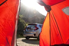 The two best things to wake up to when you're on a camping trip: the shining sun and a Honda Fit.