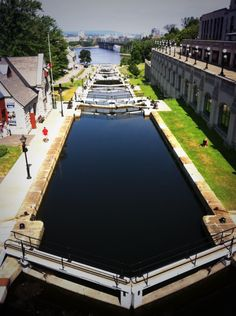 The Rideau Canal, Ontario,Canada from Ottawa to Kingston provides a lot of history for anyone cycling along the waterway. Visit Canada, O Canada, Canada Travel, Ottawa Canada, Ottawa Ontario, Toronto, Quebec, Calgary, Vancouver