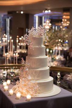 Featured Photographer: Ira Lippke Studios; Classic winter white floral five tier wedding cake