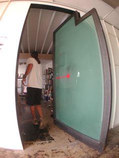 funky Pivot door built in LA for HyPe Arc studios by mike nelms