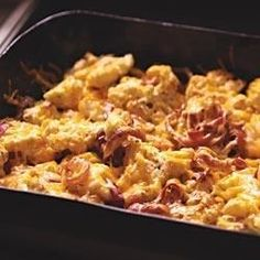 Cauliflower florets and red onion slices are oven roasted then blended with sour cream and triple Cheddar cheese in this easy and delicious side dish.