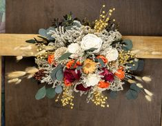 """Small wedding arch swag arrangement. Made of sola flowers in ivory, orange, burgundy and beige, filled with dried flowers, preserved eucalyptus and other greenery. With rustic wires to attach to the wedding arch. Can be made in other colors.MADE ON ORDERDimensions approx. 55cm (21 2⁄3"""") x 30cm (11 13⁄16"""")~~~~~~~~~~~~~~~~~~~~~~~~~~~~~~~~~~~~~~~~~~~~~~~~~Sola flowers are handmade from super light wood of Aeschynomene aspera. They are naturally cream/ivory in color. While they are made from wood th Fall Wedding Arches, Blush Wedding Flowers, Sola Flowers, Rustic Wedding Flowers, Dried Flowers, Wedding Bouquet, Fall Floral Arrangements, Wedding Arrangements, Wedding Flower Packages"""