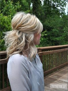 Pinned back and up with some of the back simply hanging down. This is a lovely half updo hairstyle. Works well with thin hair as well.