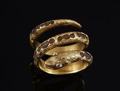 Gold mourning snake ring with diamond eyes and hair inserts