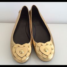 RARE TORY BURCH GOLD BALLET FLATS, SIZE 8 RARE TORY BURCH GOLD BALLET FLATS, SIZE 8, USED TWICE, NO SIGNS OF WEAR ABOVE SOLES, IN EXCELLENT CONDITION, COMES WITH BOX AND DUST BAG Tory Burch Shoes Flats & Loafers