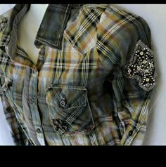 "Roar Clothing Button Up Embellished Plaid Size M ""Enough Excuses...Get It Done Passionately""  Passion to...  ROAR Clothing Button Up Embroidered with Crosses and Wings Plaid Shirt Size M  100% Cotton  36"" Bust 25"" Length Long Sleeve     Pre-Owned - Gently Used  Smoke/Pet Free Facility ROAR Clothing Tops Button Down Shirts"