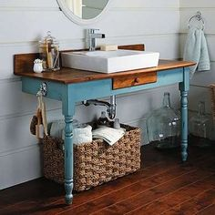 Old desk upcycled into bathroom vanity